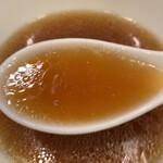 130066407 - 琥珀色で透き通ったスープ