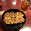 小倉鉄なべ - 料理写真:鉄なべ餃子2人前と烏龍茶