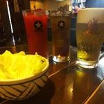 ゑびすや - ◆突き出しのキャベツ・レッドオレンジ・烏龍茶・エビス生ビール◆♪