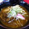 がんばり屋 - 料理写真:牛すじカレーうどん(924円)