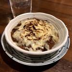 おうちあそび - 料理写真:*もつ煮(¥500) +トッピング 炙りチーズ(¥120)