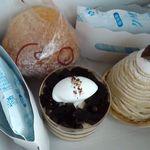 シェ・ヒロダン - 箱の中のケーキ