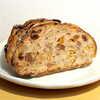 ベッカライ ツェッペリン - 料理写真:カンパーニュ・フルーツ(カット¥330)。レーズン・オレンジピール・ナッツとライ麦の風味