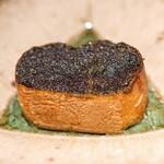 SECRETO - サザエの肝バターを塗ったトースト