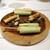 Convivio - 料理写真:イタリア風春巻 と ヤングコーンのラルド(豚肉の背脂)巻き