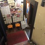 A5山形牛焼肉&食べ放題 くろべこ - 地下のお店の入口