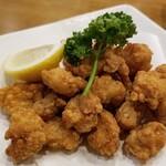 蔵元の酒と直送の魚 さかまる - 鶏軟骨唐揚げ。