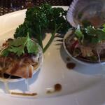 134786441 - 蛤、イシガケ貝の蒸し物。(XO醬、ガーリック)