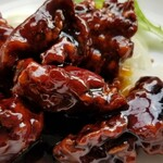 高園 - 黒酢鶏近影 黒酢ソースがこってりとして美味! 鶏もカラッと揚がってジューシー。とても好み♪