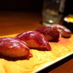 135383568 - 上質なマグロをおもわせる馬肉寿司。