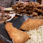 伝説の串 新時代 - アジフライ、食べかけ。