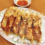 餃子の王将 - 料理写真:餃子(よく焼き)!写真は2人前です!