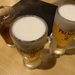 肉八や - 生ビールと黒ウーロン茶