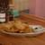タイレストラン&オイスターバー トンファー - 料理写真:お通しの海老せんべい