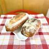 Boulangerie MAISON NOB - 料理写真:しだりトラディショナルバゲット みぎオリーブとトマトのリュスティック