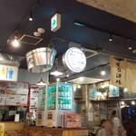 野毛韓兵衛 野毛一番街店 - 一番街を正面から入って一番奥の店舗、チャミスルのショーケースと暖簾が目印