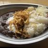 カレーのチカラ - 料理写真:北見たまねぎカレーの温玉トッピング