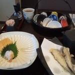 13798297 - 出し巻き卵と鮎の天ぷら…の食べかけ(笑) 奥はお猪口たちが入った籠