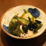 ごっつり - 2012.7 お通し(200円)豚バラ、キュウリ、海草などの酢の物