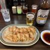 Abenomimmin - 料理写真:焼ぎょうざ+ビール大びん
