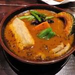 138621928 - スープカレーチキンにタフゴレン(揚げ出し豆腐)をトッピング、スープ大盛り