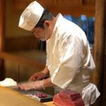 Nishikawa - 鮪を切る店主