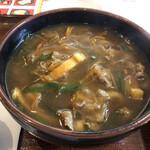 Sanukiudonharushin - やや透明感のある和風カレーの出汁。