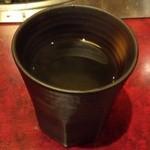 もつ彦 - 熱いお茶をいただき、完食(^^)
