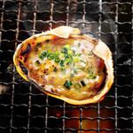 磯丸水産 - 磯丸水産 不動の一番人気!蟹味噌甲羅焼き