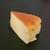藤堂プランニング - 真ん中はスフレチーズ、このお尻側が少し固めで味濃い目で美味しい。