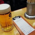 140442589 - 生ビール小と会計伝票
