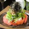 こうね - 料理写真:おぼろ豆腐とトマトのサラダ  ¥690 自家製のゴマドレッシングがくせになります!