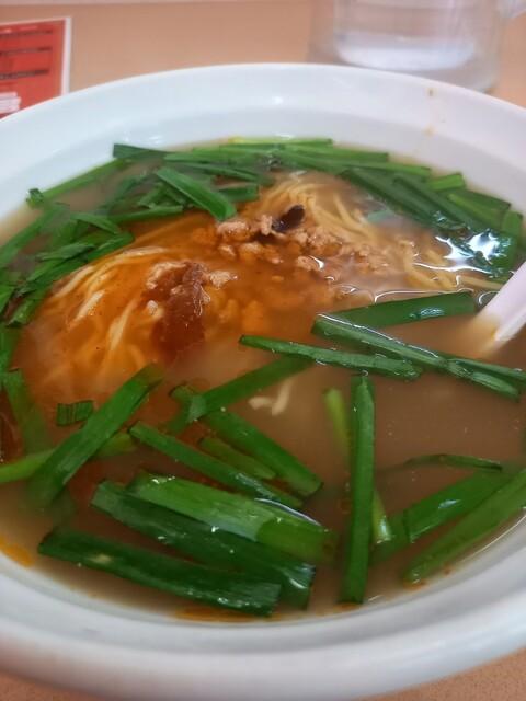 中国料理 九龍居 三好店 - 台湾ラーメン。ニラが多め。しかも辛い。汗が止まらん☀️ひき肉が少なかった