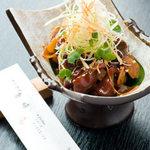 金峰 - 砂肝にんにく焼き(コリッとした食感と濃厚な味がお酒のおつまみに最適)