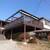 ソースカツ丼・そば きりの実 - 外観写真:高台に建つログハウス