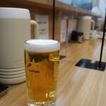 餃子会館 - 生ビール(キリン550円税込)。