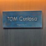 TOM Curiosa -