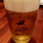 トラットリア ピッツェリア アミーチ - 生ビール ¥700