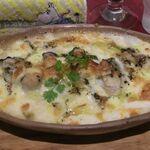 143636562 - 牡蠣のバジルソースドリア
