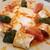 Stella Dining&Bar - 料理写真:Beyti Kebabı(ベイティケバブ)「ラム&ビーフのひき肉ケバブのクレープ巻き。ヨーグルトソース添え。」(Minced lamb & beef kebab seved a crepe, and topped with spicy tomato sauce.) ※メニュー表記通り