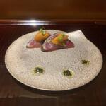 144306306 - 長崎産戻り鰹の藁焼き 北海道産ばふん雲丹 大葉のソース