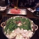 和食Dining 黒田 - もつ鍋とトマト。