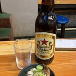 いづみや - 料理写真:ビンビール 大ビール+いづみや名代もつ煮込み