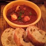 ピッコロジャルディーノ - タコのトマトソース煮込み