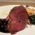 ラチュレ - 料理写真:北海道の蝦夷鹿のロースト 鹿の内もも肉ですが、大きな物が二切れ、凄いボリューム感です‼ 赤色の断面の美しさが、じっくりと時間をかけて火入れした証拠、とても美味しいです。 ソースはグランヴヌールソース、赤ワインをベースに、赤スグリ(果実)と黒胡椒の少し甘酸っぱいもの、濃厚な味わいで淡白な鹿肉ととても合っています♪