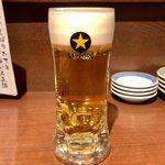 磯べゑ - サッポロ黒ラベル(中ジョッキ) ¥550