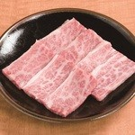 炭火焼肉 ぎゅうばか - 国産特上カルビ。霜降りの当店一番人気商品です。680円(税抜)