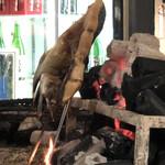 145751907 - 金華サバを焼いています。