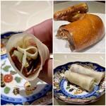 新広東菜 銀座 嘉禅 - 嘉禅名物焼きたて北京ダック2本 2本付くのはとても嬉しいです♪ 皮がモチモチ、そこにアヒルの皮のパリパリさと美味しい脂、甜麺醤の甘味と白髪葱のシャキシャキさ、これこそ本当の北京ダック、美味しいです♪