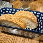 147420987 - 自家製シチリア風味の胡麻パン  1切/125円